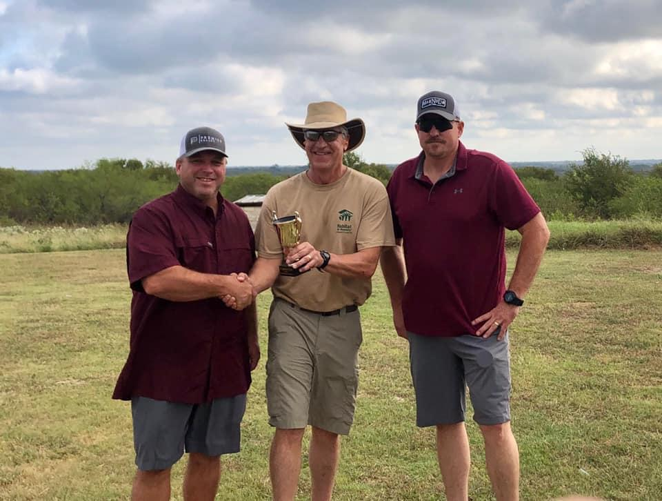 Sheriff Tanner congratulates NCSO team of Captain Stan Farmer and Sergeant Jeff Harbuck as this years champions of the Habitat for Humanity Skeet Shoot