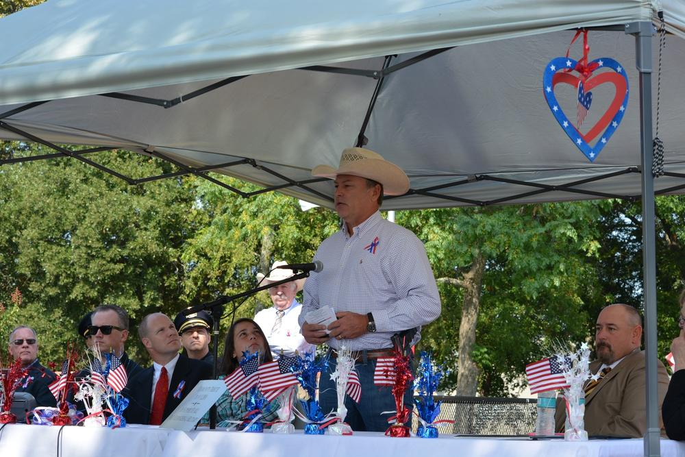 Navarro County Officers speaking at the Patriot's Day Ceremony at Bunert Park