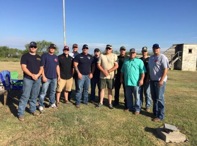 Captain Stan Farmer and Sgt. Jeff Harbuck and other officers pose together after winning the 2015 Habitat For Humanity Meat and Skeet