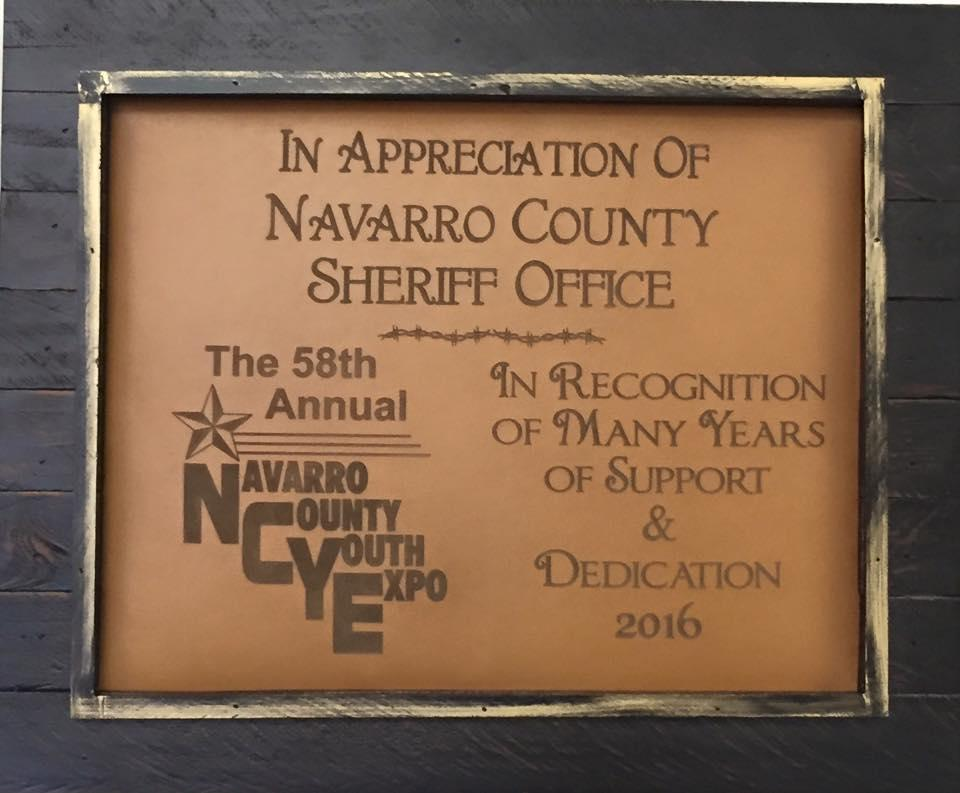 "Plaque reads ""in appreciation of Navarro County Sheriff Office. In recognition of many years of support and dedication. The 58th annual Navarro County Youth Expo."""